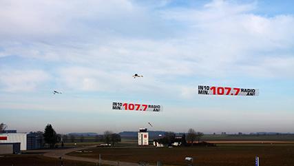Flugzeugbanner-Galina Flugwerbung und Luftwerbung Doppelschlepp Radio 107.7